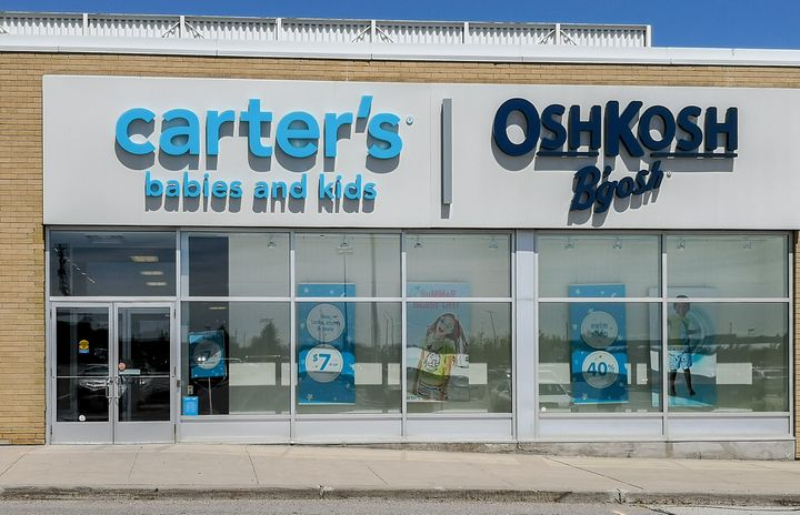 A Carter's OshKosh B'gosh storefront located in Oakville, Ont. The chain is taking heat on social media over the apparent discovery of unsold clothes in a garbage bin near a Toronto store.