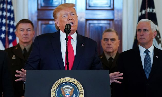 U.S. President Donald Trump delivers a statement about Iran flanked by U.S. Army Chief of Staff General...