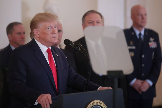 U.S. President Donald Trump is accompanied by Vice President Mike Pence, Secretary of State Mike Pompeo...