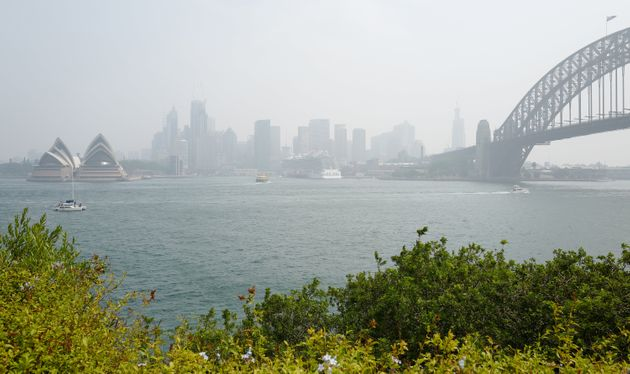 The Harbour Bridge and Opera House surrounded by smoke on January 08,