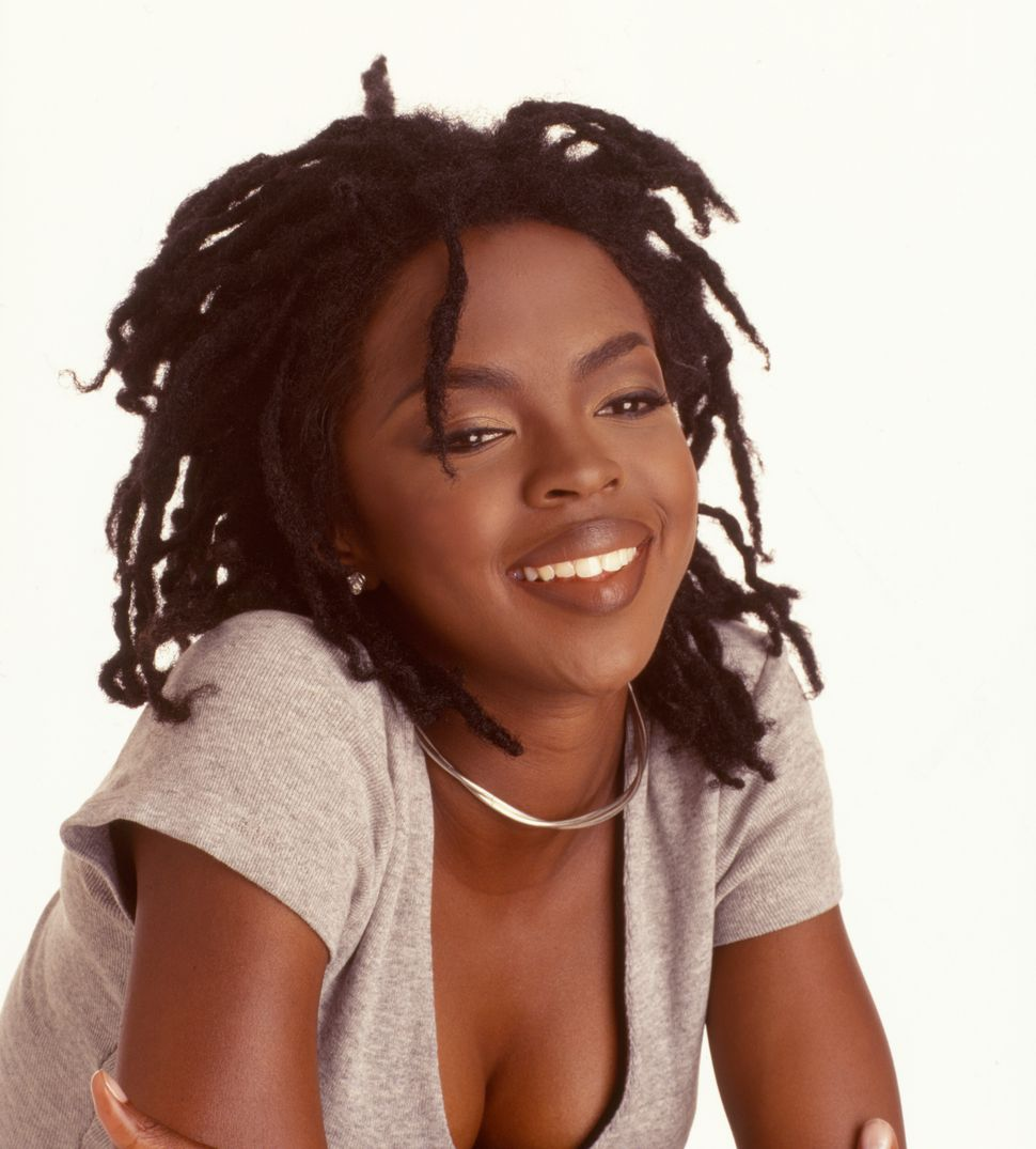 Portrait of American pop and rhythm & blues musician Lauryn Hill as she poses against a white background, 1998.