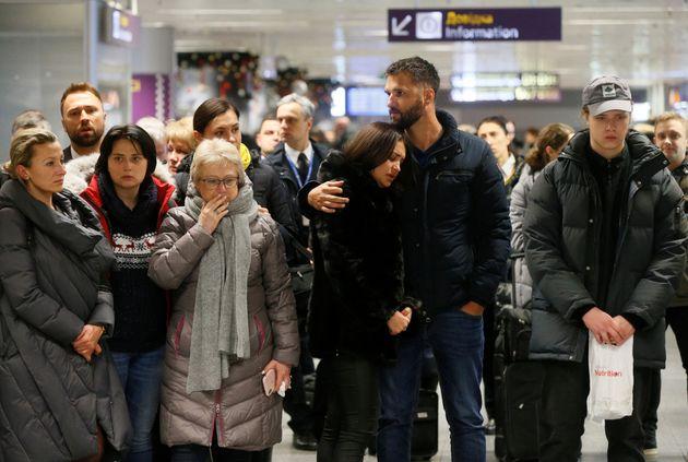 People react in front of a memorialJan. 8, 2020. for the flight crew members of the Ukraine International...