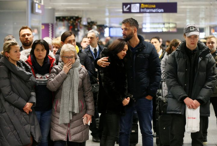People react in front of a memorialJan. 8, 2020. for the flight crew members of the Ukraine International Airlines Boeing 737-800plane that crashed in Iran.