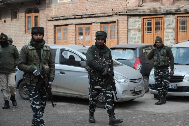 Paramilitary soldiers patrol near the site of an explosion in Srinagar, Kashmir, Saturday, Jan. 4,