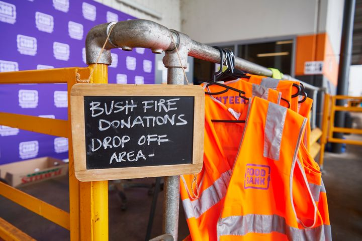 A sign shows the public where to unload donated goods at the Food Bank Distribution Centre bound for areas impacted by bushfires on January 07, 2020 in the Glendenning suburb of Sydney, Australia.