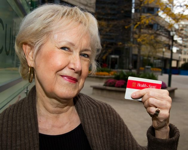 Ontario resident Linda Hogarth poses with her red and white health card in 2010. She wanted to become...