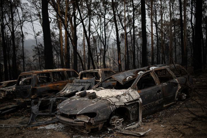 Destroyed cars are seen next to burnt bushland in the village of Mogo, Australia on Jan. 8, 2020.