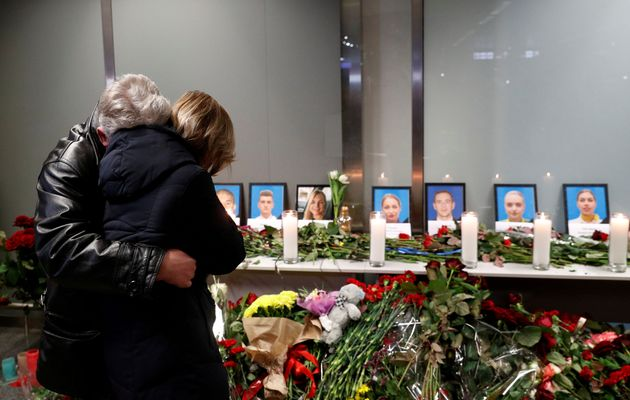 Relatives of the flight crew members of the Ukraine International Airlines Boeing 737-800plane that...