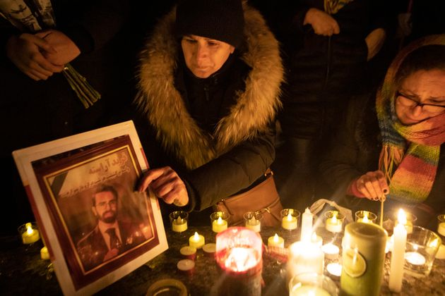 A photograph is placed at a memorial during a vigil in Toronto, Thursday, Jan. 9, 2020, to remember the