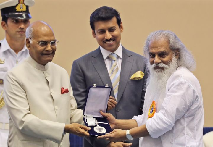 President Ram Nath Kovind, confers the Best Male Playback Singer award to K.J. Yesudas during the 65th National Film Awards ceremony in New Delhi, in 2018.