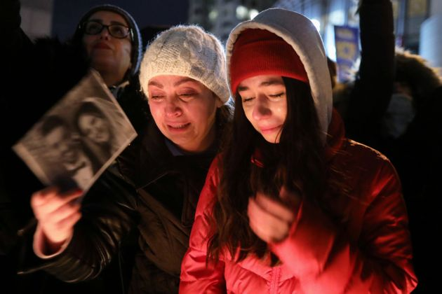 Mourners in Toronto attend an outdoor vigil on Jan. 9, 2020 for the victims of a Ukrainian plane that...