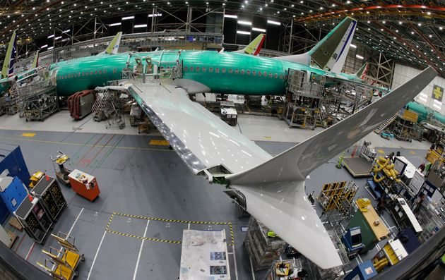 In this March 27, 2019, photo taken with a fish-eye lens, a Boeing 737 MAX 8 airplane sits on the assembly...