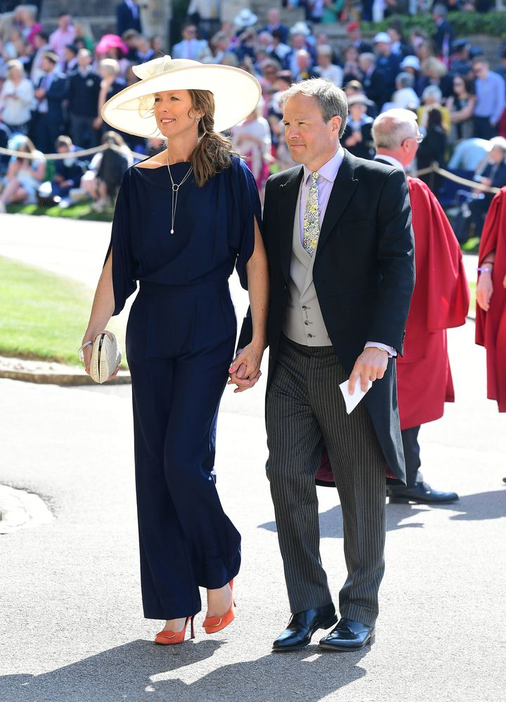 Tom and Claudia Bradby arrive at St George's Chapel at Windsor Castle before the wedding of Prince Harry to Meghan Markle on