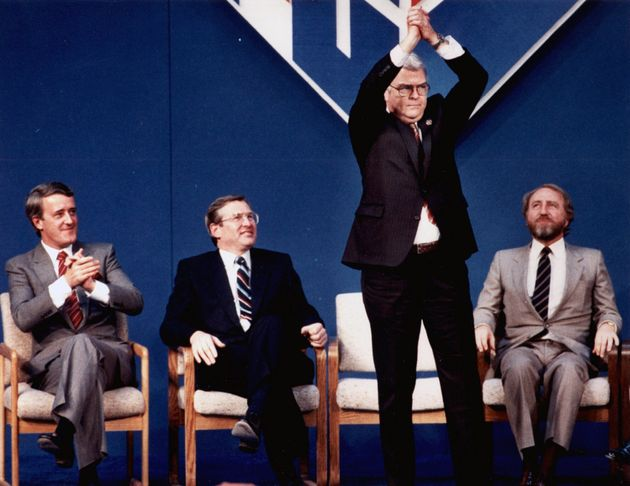 John Crosbie raises his hands above his head during introductions at the opening of the PC convention...