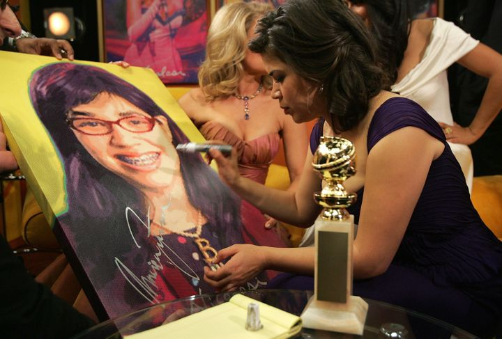 America Ferrera signs a piece by pop artist Nicolosi after winning a Golden Globe Award for Best Performance by an Actress in