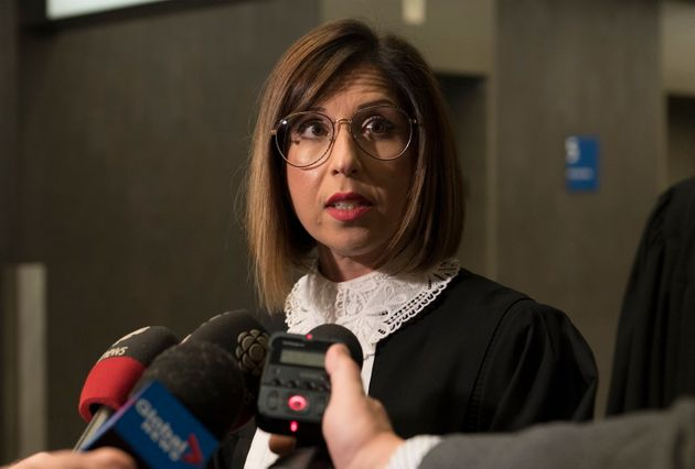 Crown prosecutor Anne-Marie Manoukian speaks to reporters at the courthouse in Montreal on