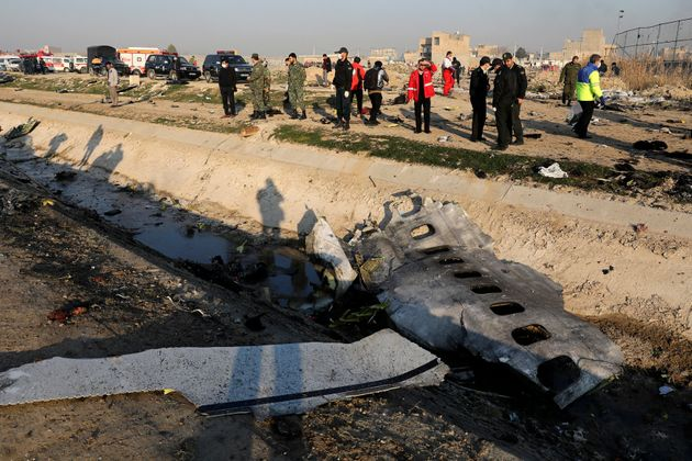Debris is seen from a Ukrainian plane which crashed as authorities work at the scene in Shahedshahr,...
