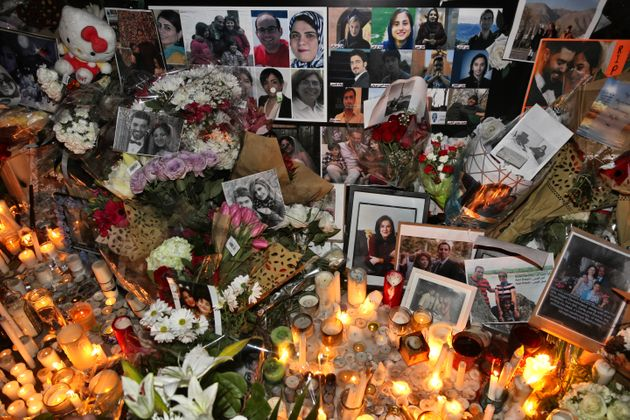 A memorial is seen during a candlelight vigil at Mel Lastman Square in Toronto on Jan. 9, 2020 for the...
