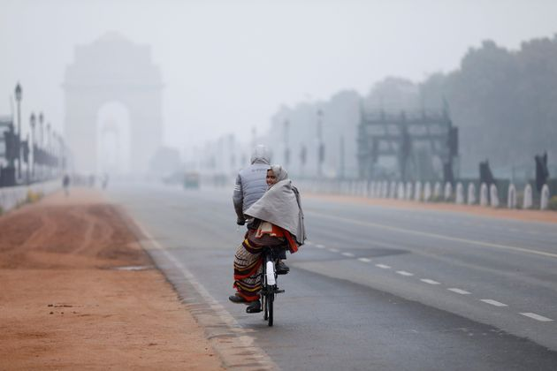File photo of a woman sitting behind a bicycle on a cold winter morning in New