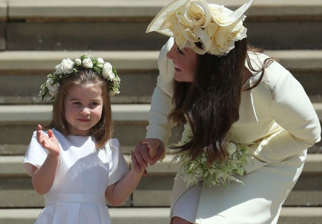 TOPSHOT - Princess Charlotte (L) waves by her mother Britain's Catherine, Duchess of Cambridge after...