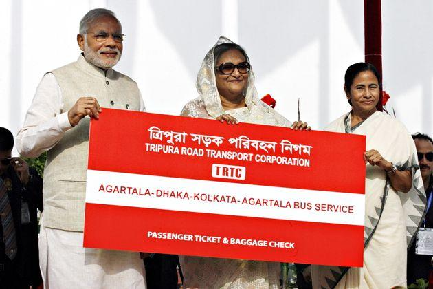 India's Prime Minister Narendra Modi (L), Bangladesh's Prime Minister Sheikh Hasina (C) and Chief Minister...