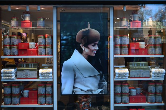 Royal memorabilia featuring Meghan, Duchess of Sussex (C) is displayed for sale in a store near Buckingham...