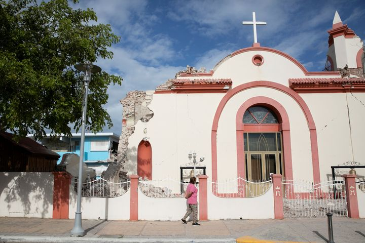 A woman walks in front of a damaged church after the earthquake in Guayanilla, Puerto Rico, January 9, 2020.