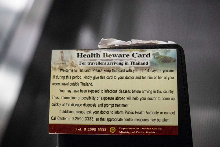"""A """"Health Beware Card"""" handed out by officials after performing thermal scans on passengers arriving from Wuhan, China at Suvarnabumi Airport on Jan. 8, 2020 in Bangkok, Thailand."""