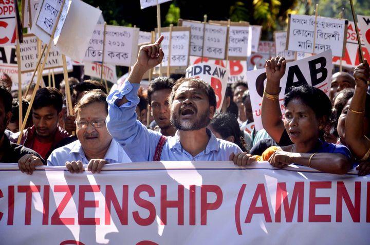 Krishak Mukti Sangram Samiti (KMSS) Advisor Akhil Gogoi along with KMSS activist raise slogans during a protest against the Citizenship Amendment Bill (2016) in Guwahati, Assam, Nov. 22, 2019.