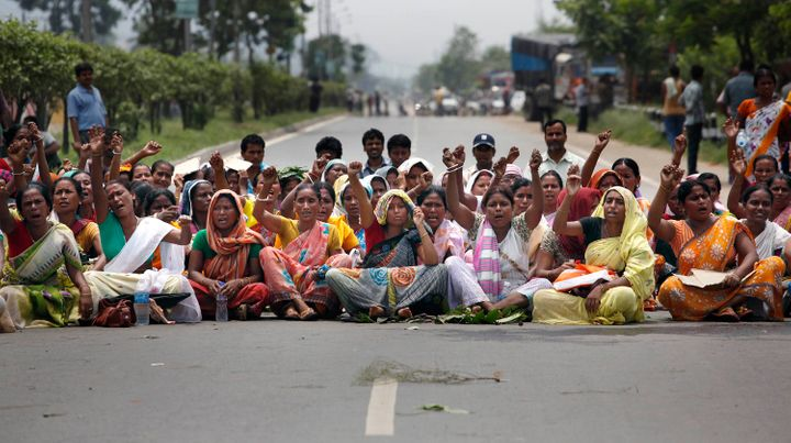 Evicted people from nearby hills, who were living in the forest area for years, block a national highway during the 12-hour general strike in protest against the arrest of Akhil Gogoi, June 25, 2011. Gogoi was fighting for the rights of the evicted people.