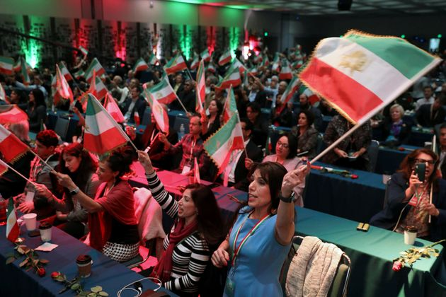 Attendees wave flags as Iranian Americans from across California converge in Los Angeles to participate...