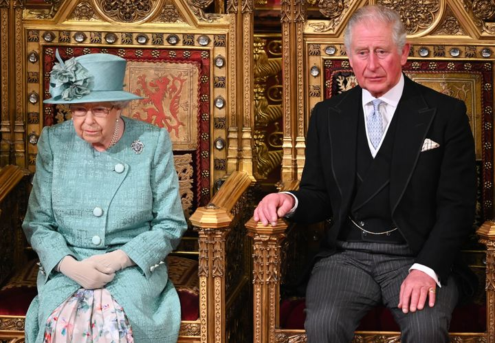 Queen Elizabeth II and Prince Charles, Prince of Wales attend the State Opening of Parliament in the House of Lord's Chamber on Dec. 19, 2019.