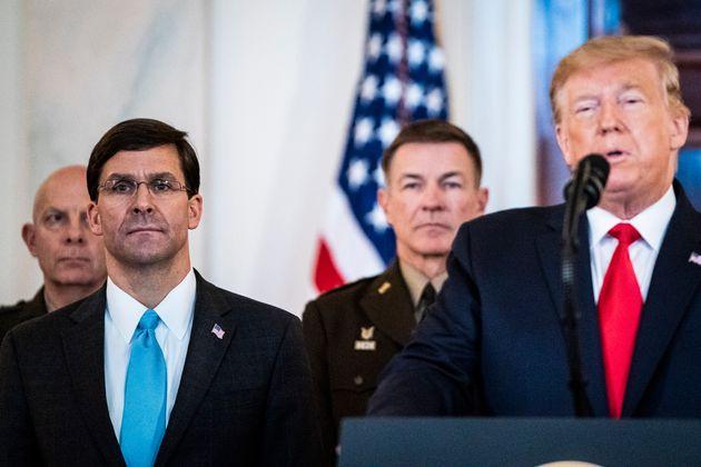 WASHINGTON, DC - JANUARY 8 : Secretary of Defense Mark Esper listens as President Donald J. Trump address...