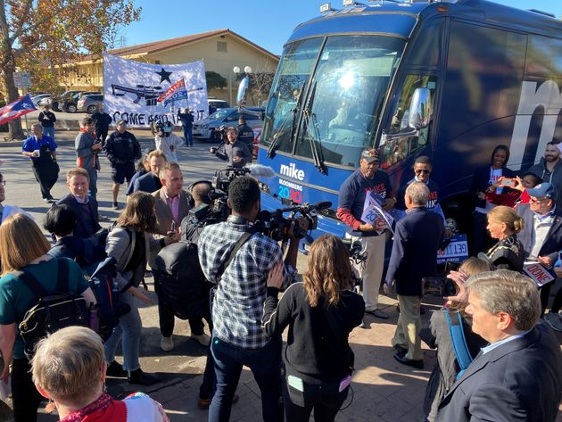 People crowd around U.S. presidential candidate Michael Bloomberg's campaign bus in San Antonio, Texas,...