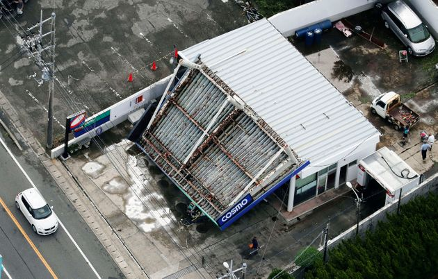 The rooftop of a gas station is collapsed after typhoon hit the area in Tateyama, south of Tokyo, Monday,...