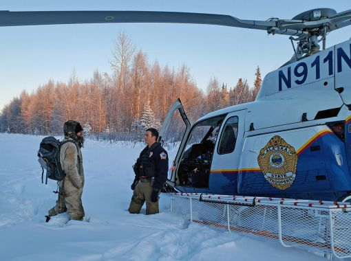 Tyson Steele is greeted by Alaska State Trooper's tactical flight officer Zac Johnson after more than 20 days in the wilderne