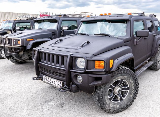 Samara, Russia - May 18, 2019: Black luxury Hummer cars parking at the city