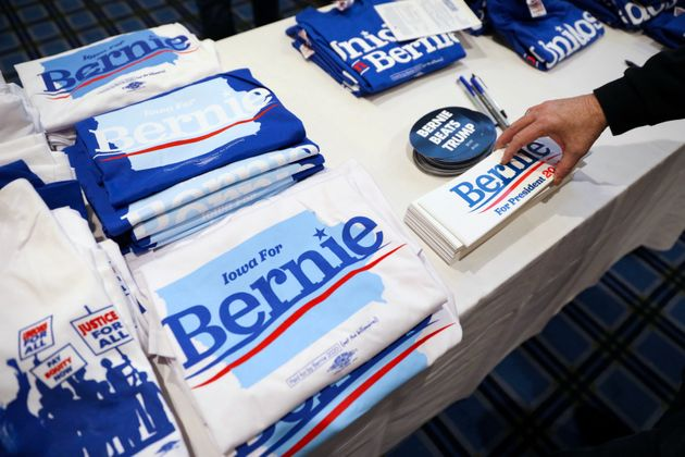 Supporters pick up bumper stickers of Democratic U.S. presidential candidate Senator Bernie Sanders at...