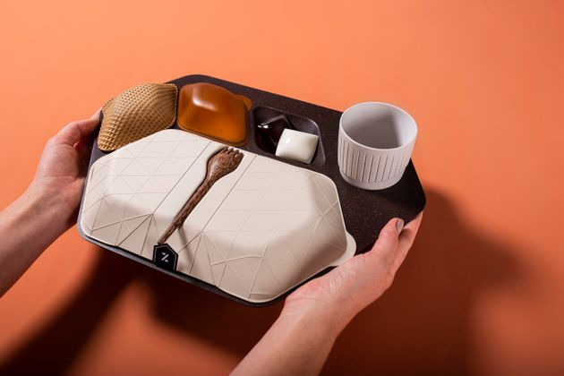 The economy meal tray designed by PriestmanGoode is made frommaterials including coffee grounds...
