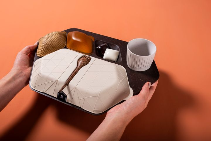The economy meal tray designed by PriestmanGoode is made frommaterials including coffee grounds and husks, wheat bran,