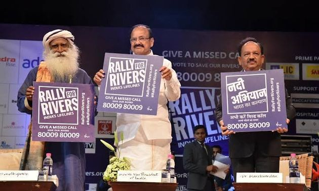 Vice President Venkaiah Naidu and Isha Foundation's Jaggi Vasudev placard with 'missed call...