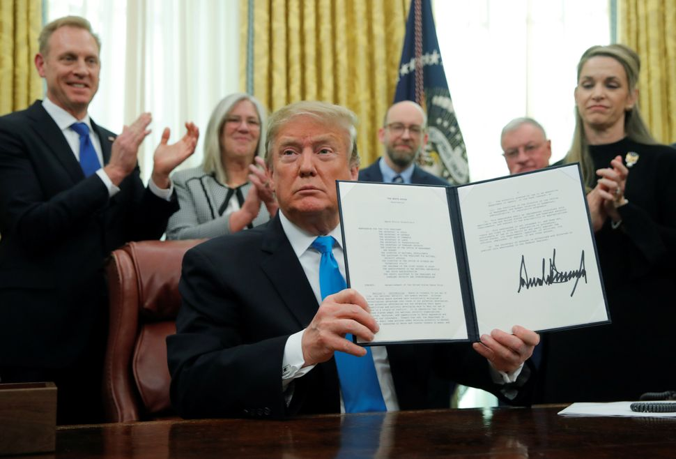 "President Donald Trump displays the ""Space Policy Directive 4"" establishing a Space Force as the sixth branch of the armed fo"