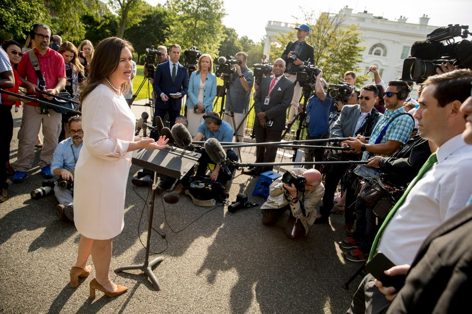White House press secretary Sarah Huckabee Sanders speaks to reporters on the North Lawn outside the White House on May 23, 2