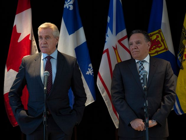 N.L. Premier Dwight Ball and Quebec Premier Francois Legault address the media during the Atlantic Premier's...