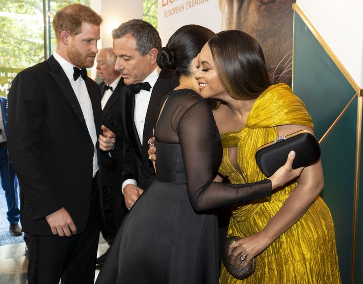 "Harry chats with Disney CEO Robert Iger as Meghan embraces Beyoncé as they attend the European premiere of the ""The Lion King"" in London on July 14, 2019."
