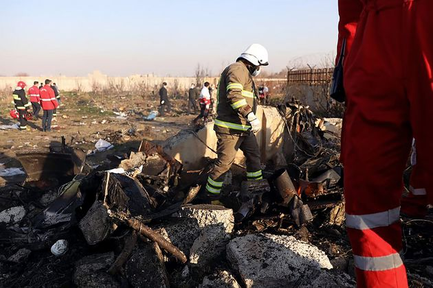 Rescue teams are amid the wreckage after a Ukrainian plane carrying 176 passengers in Tehran on Jan....
