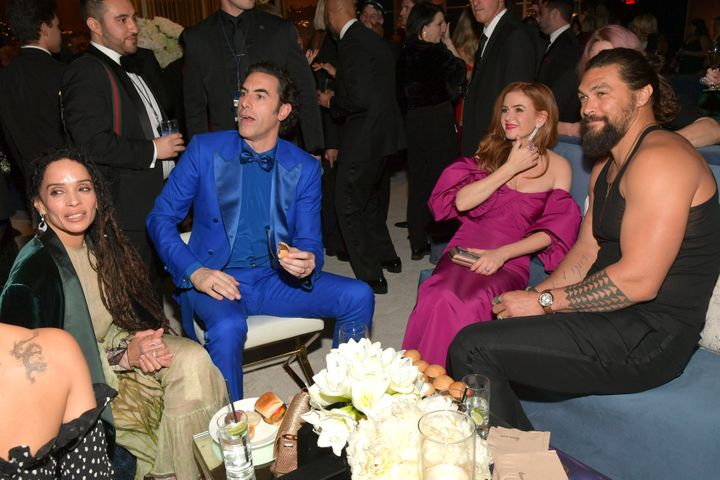 Jason Momoa (right, pictured with Lisa Bonet, Sacha Baron Cohen and Isla Fisher) later reappeared in the tank top at a Golden Globes after-party.