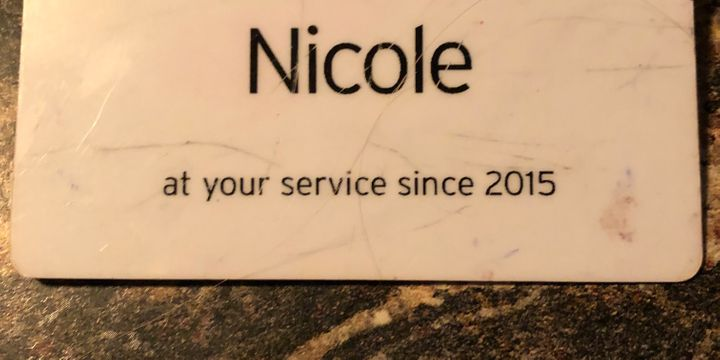 The name tag Nicole Johnson wore while working at a grocery store.