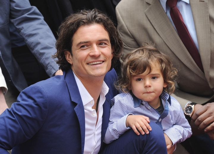 Orlando Bloom and his son, Flynn, attend the ceremony in honor of his new star on the Hollywood Walk of Fame on April 2, 2014.