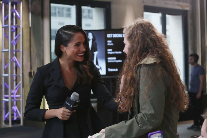 Meghan Markle meets Emily, a fan who she connected with on Twitter, at AOL Build in 2016.